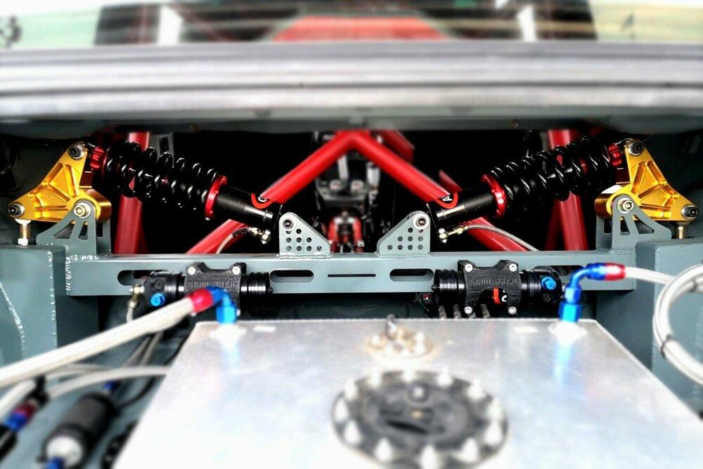 e30-bmw-pushrod-suspension-setup.thumb.jpg.5555f2431dd749ff554209eb909b1ed4.jpg